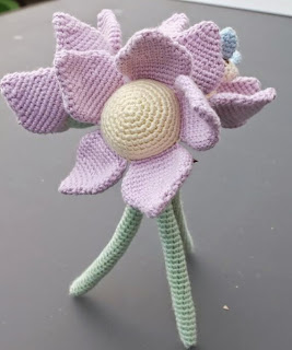 http://www.craftsy.com/pattern/crocheting/toy/flower-with-bee-amigurumi/105729