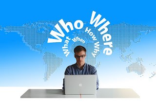 who-what-when-how-why-where-text-image-with-a-man-sitting-on-computer-table