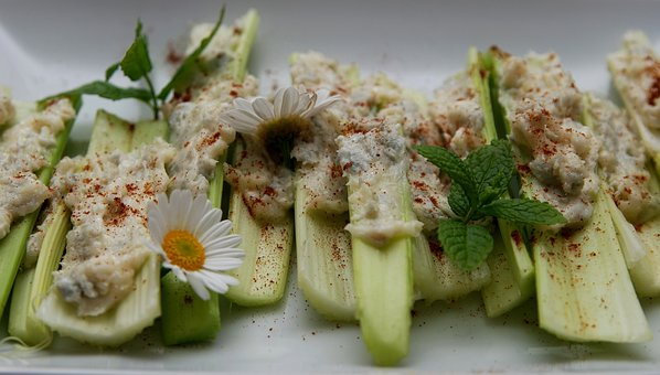 celery stuffed with hummus appetizer