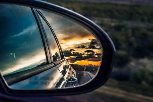 Side mirror showing the sky