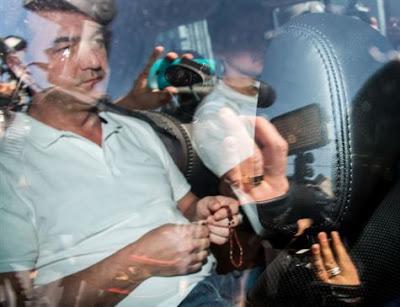 Com terço nas mãos, Joesley segue para carceragem em Brasília
