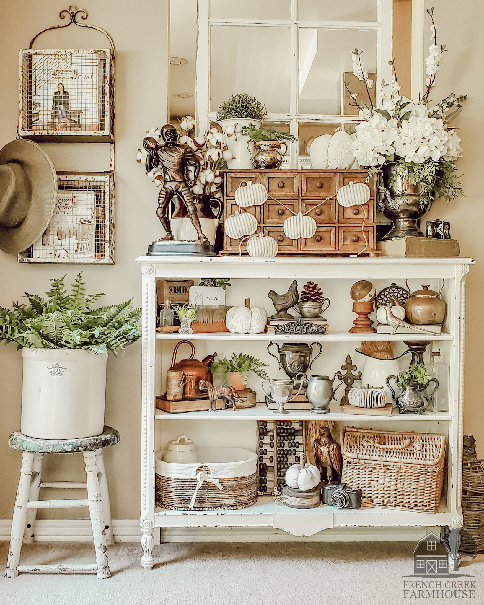 Antique bookshelves are decorated with vintage items for fall