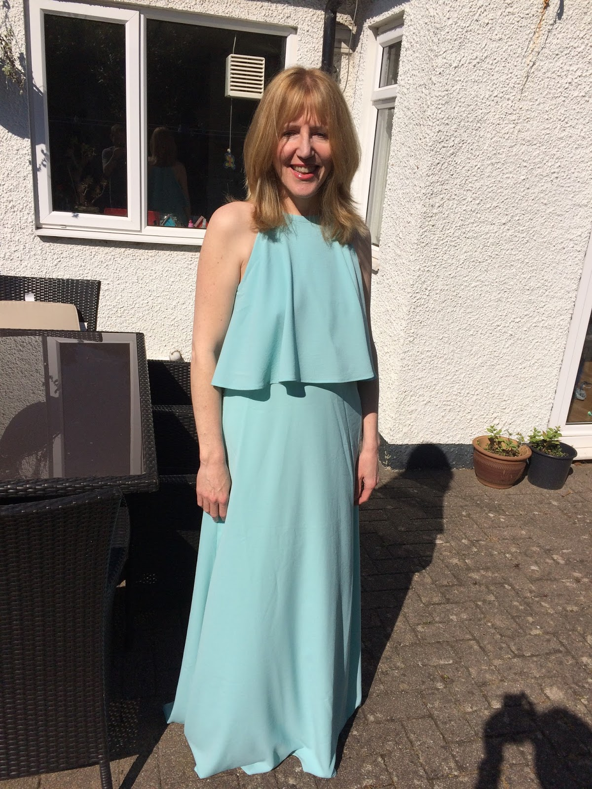 Linda Hobbis wearing a green maxi dress from Octer
