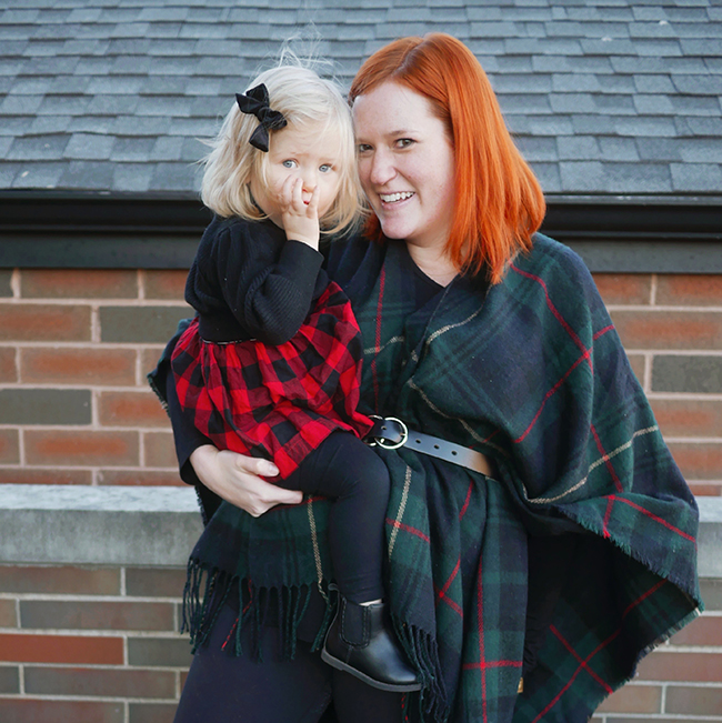 Match your toddler daughter this year with coordinating holiday outfits. A plaid dress with a velvet bow for your daughter, and a plaid poncho for you make the perfect outfit combo for a Christmas Card, Holiday Card, or Christmas Day outfit.
