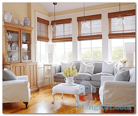 Ide 06: Desain lantai kayu ruangan serta rak perabotan kayu dengan sofa warna krem menambah suasana ruangan lebih tenang dan nyaman