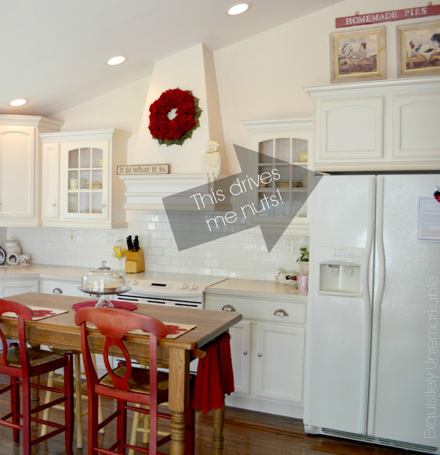 Bisque Kitchen with arrow pointing to regrets with space over fridge