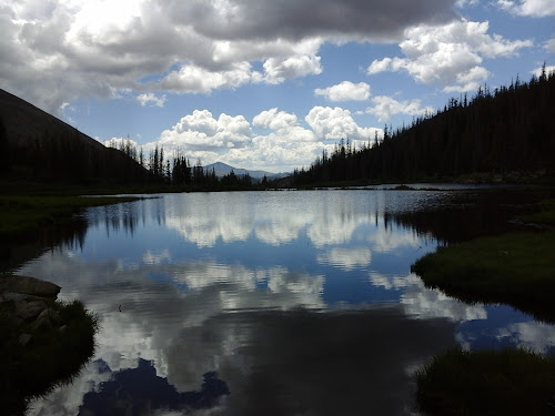 Exterior view of lake with the reflection of the clouds.