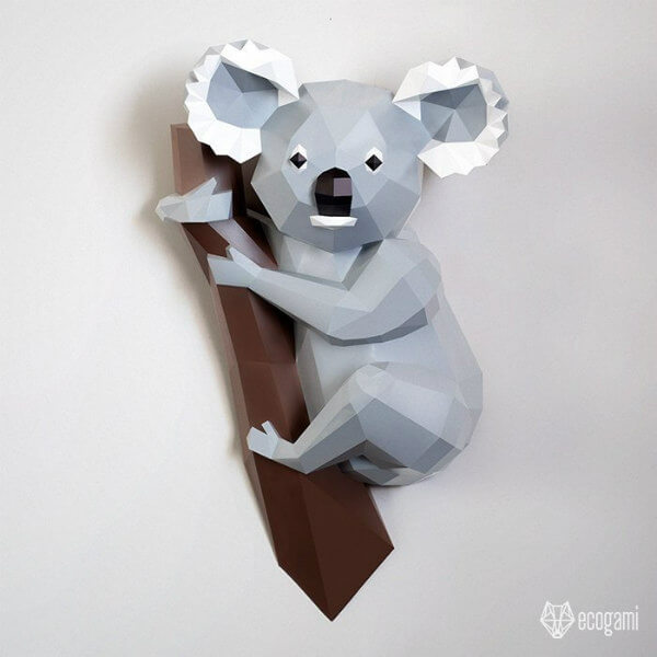 folded paper koala holding onto branch sculpture