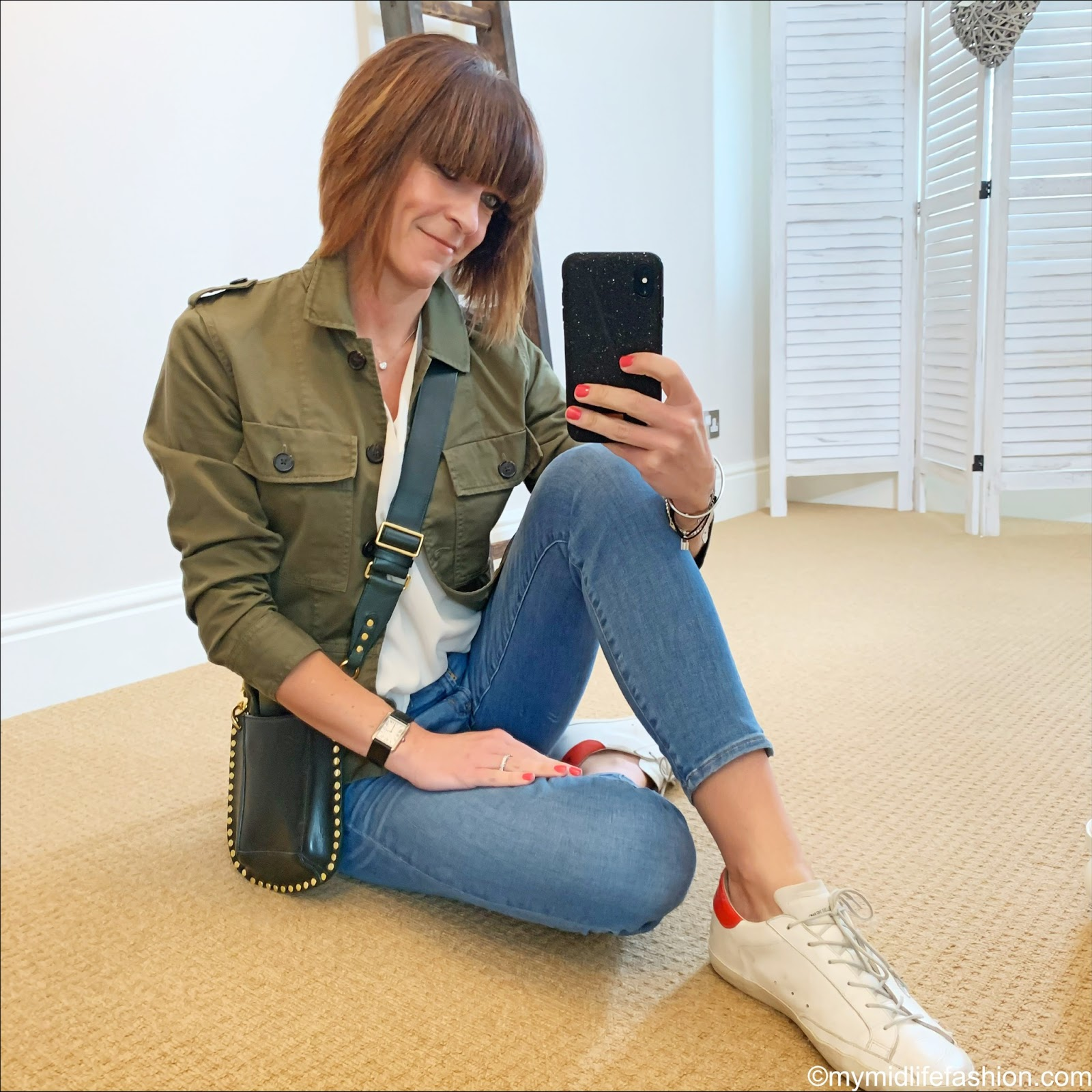 my midlife fashion, j crew shacket, Isabel Marant Etoile studded leather cross body bag, Alexis silk top, j crew toothpick 8 inch skinny jeans, golden goose superstar low top leather trainers
