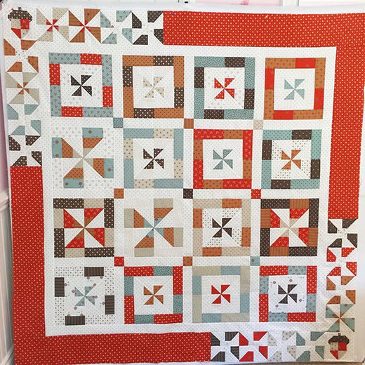 Twist and Shout Quilt made by Carolannteacup, used 101 Maple Street Fabric by Bunny Hill Designs, and Lori Holt's acorn pattern for the corner blocks. The Tutorial designed by Jenny of Missouri Quilt Co