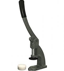Máquina para forrar botones de capitoné
