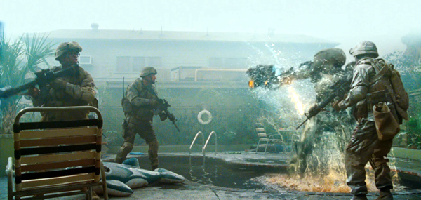 U.S. Marines confront an alien attacker in BATTLE: LOS ANGELES.