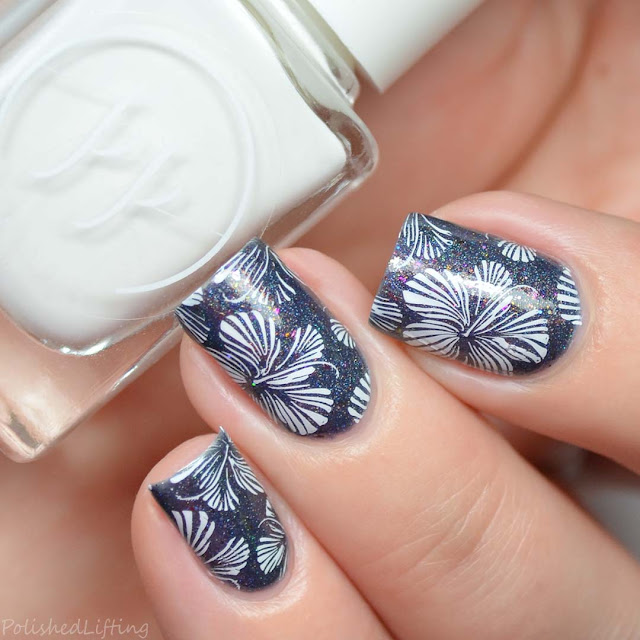 floral stamping over navy nail polish