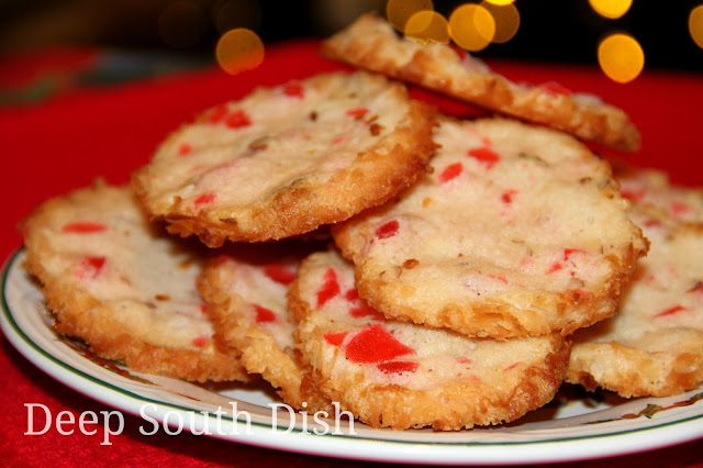 Santa Claus Whiskers Cookies - a slice and bake butter cookie, filled with chopped candied cherries and pecans, and rolled in coconut before baking.