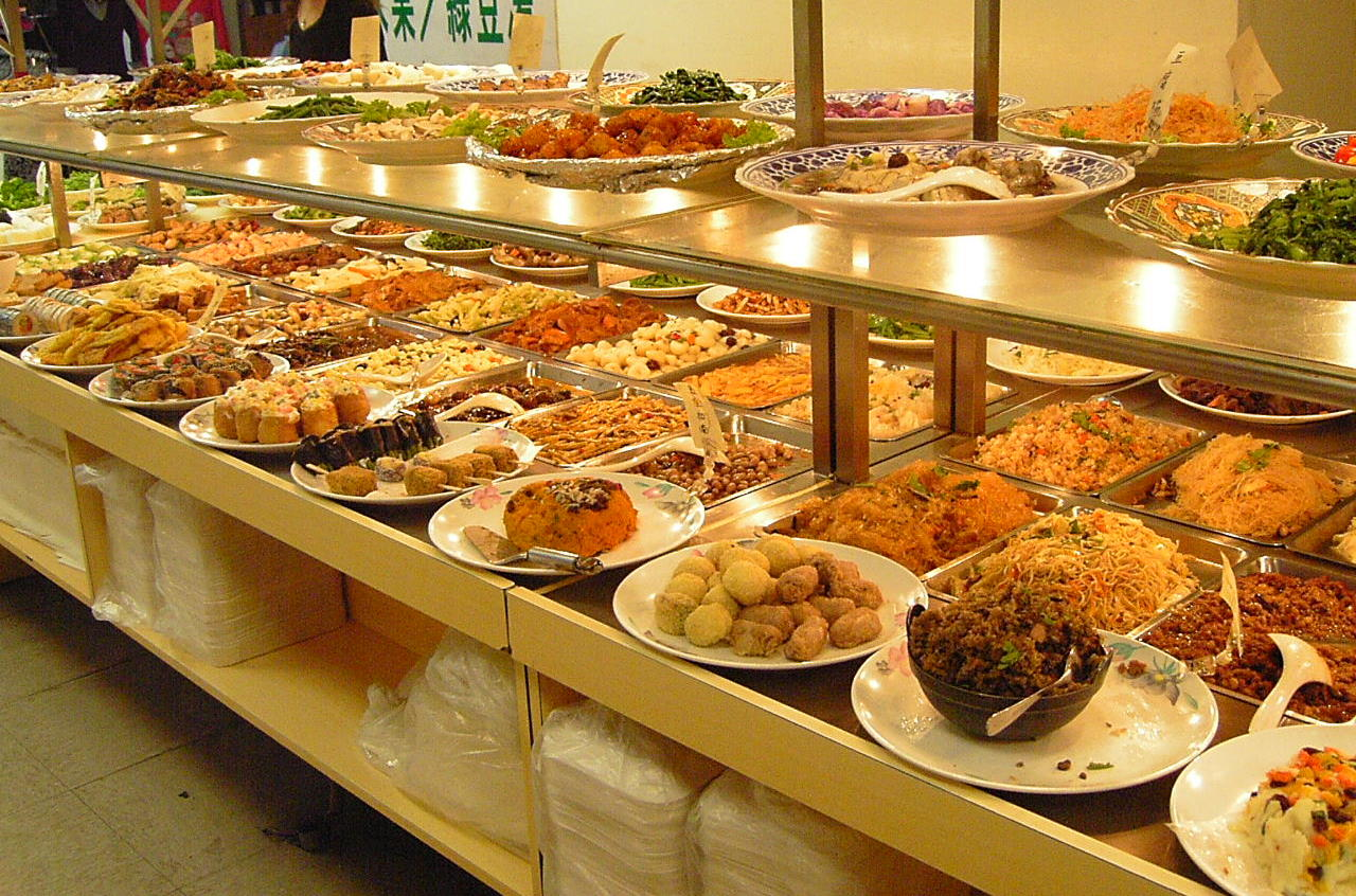 Family Style Platters Of Food Are Placed At Each Table Wedding Guests Help Themselves And P The Around To One Another