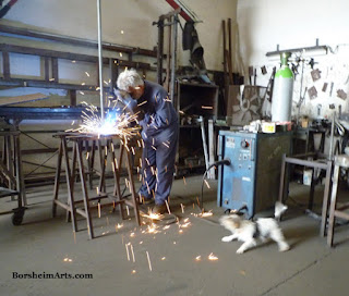 welding, sculpture armature, dog barking at fire, Tuscany, Italy
