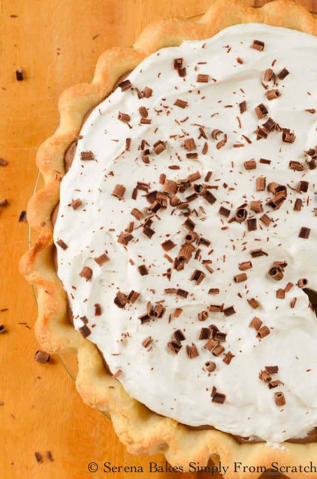 Chocolate Pudding Cheesecake covered with Whipped Cream and Chocolate Curls is a favorite dessert recipe for Thanksgiving and Christmas from Serena Bakes Simply from Scratch.