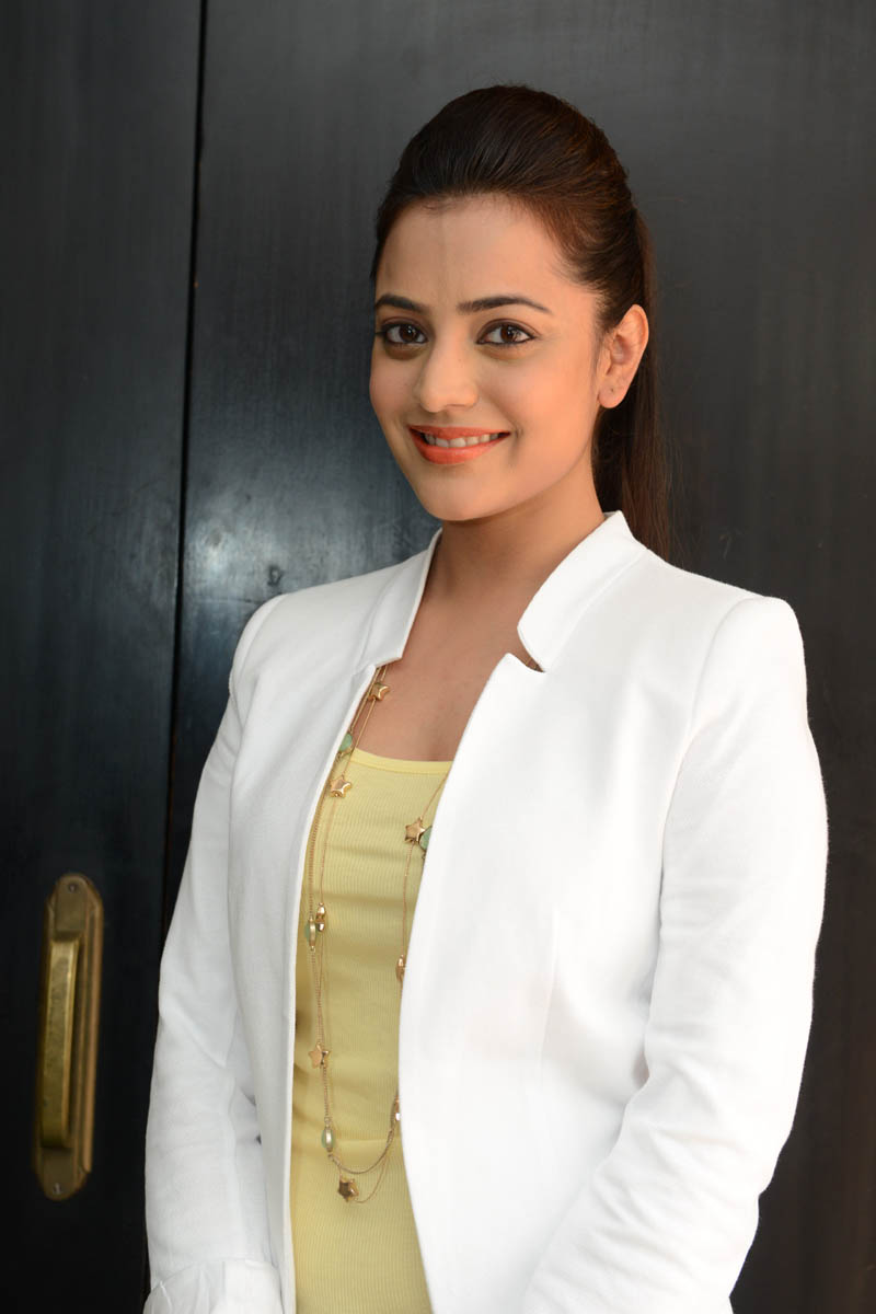 hot deshing sexy stylish Nisha agarwal latest photos in white coat at sukumarudu pm