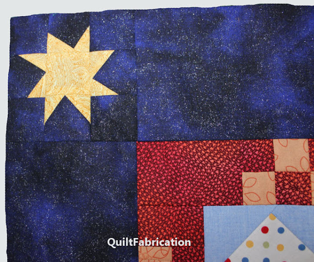 yellow wonky star in a blue quilt border