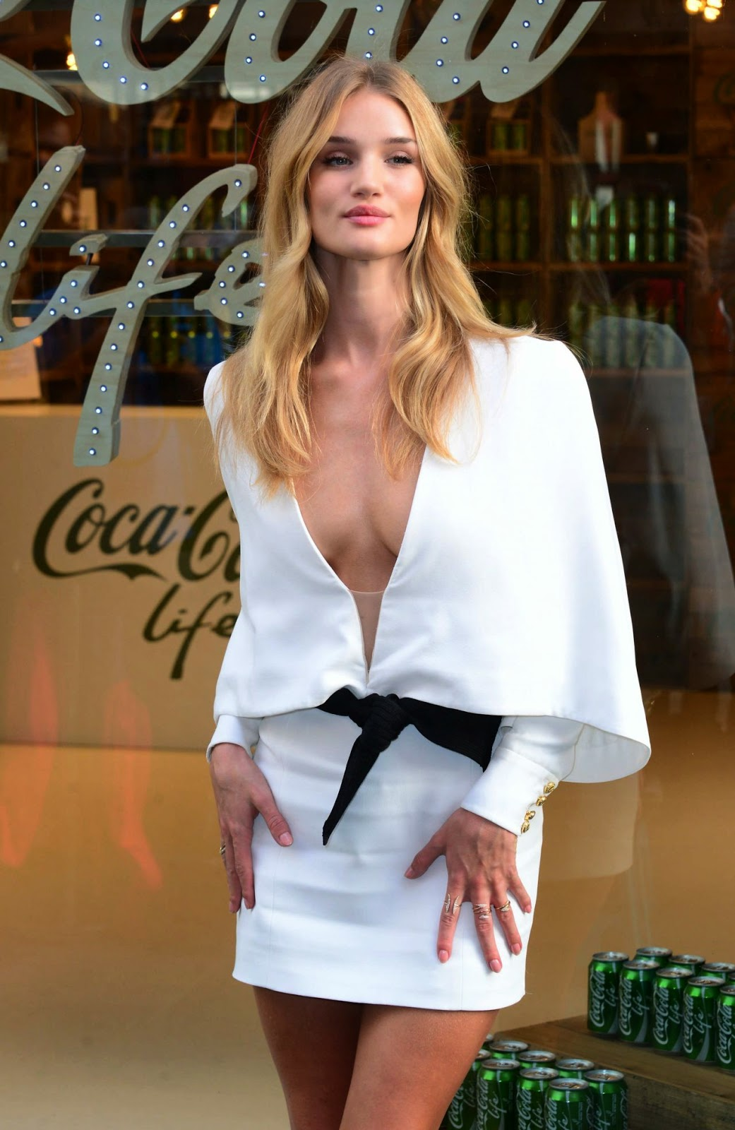 Rosie Huntington Whiteley Shows Off Cleavage And Long Legs