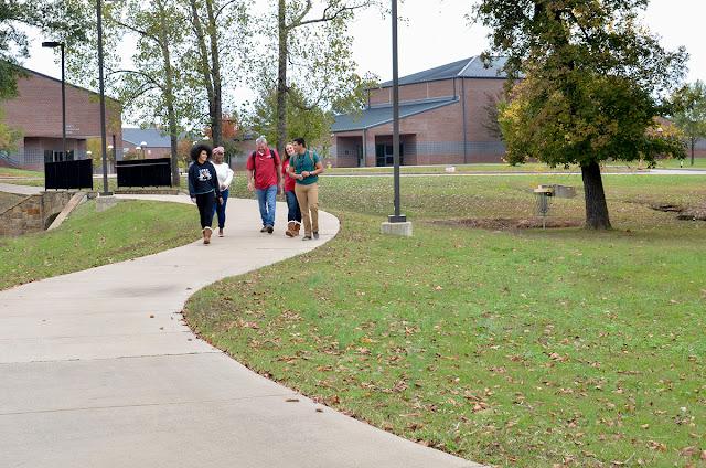 students walk along walkway