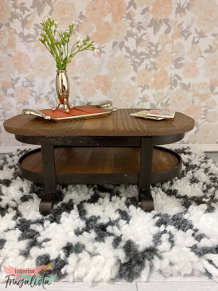 How to repurpose a bathroom metal soap and lotion dispenser caddy into an adorable rustic industrial-style dollhouse coffee table with wood slat top.