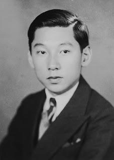 A black and white photograph of Takanobu Mitsui.