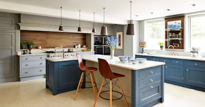 Charming kitchen style ideas with white countertops and wooden backsplash also the awesome pendant lamps