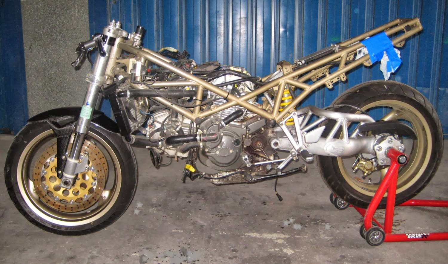 medium resolution of  first steep dismount the bike and fit the s2r single side swingarm and wheel mounting the clip ons and began the reposition of the electrical wiring and
