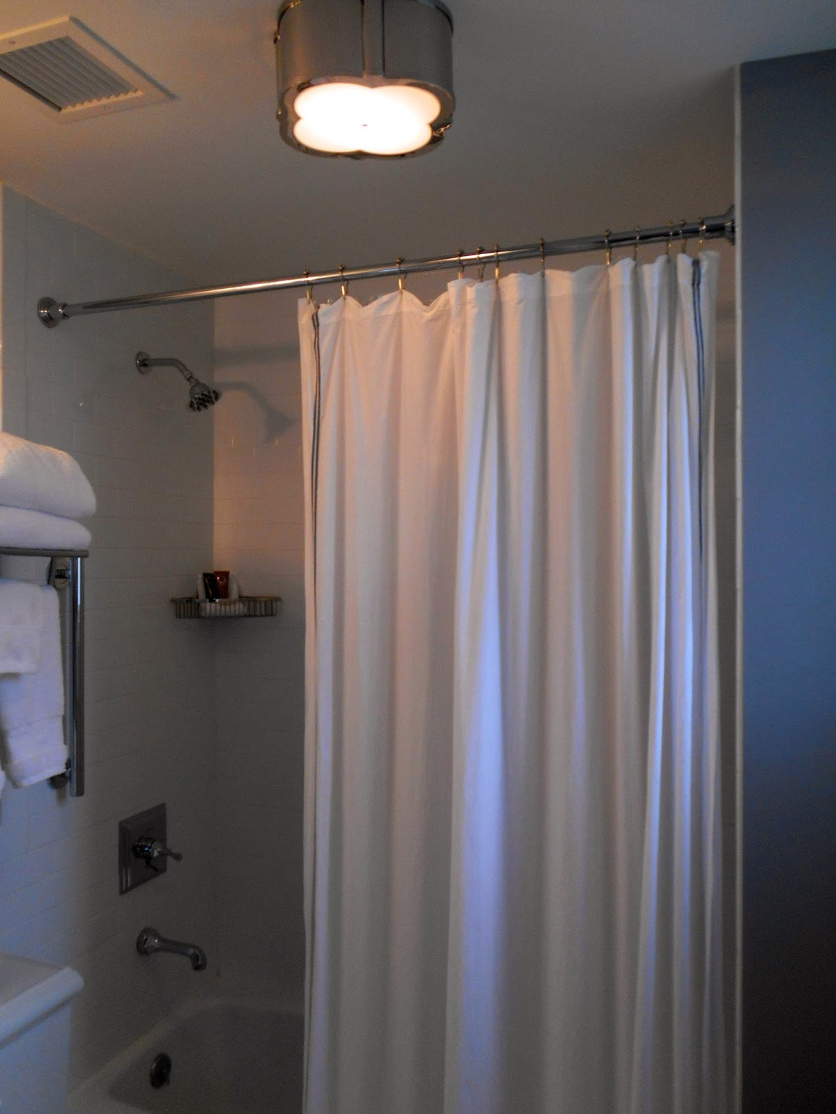 the shower curtain was cotton with thin gray striped trim