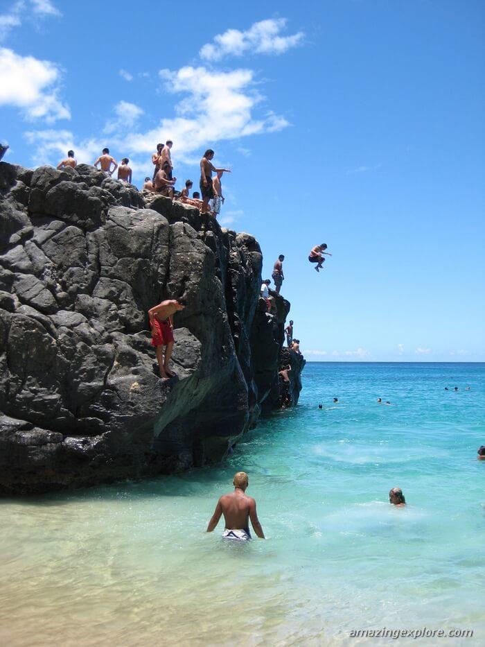The crowd of people enjoys Jump Rock, Waimea Bay, Oahu-Hawaii.  Best Honolulu-Oahu Attractions - Things to Do in Honolulu-Oahu
