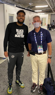 Dr. Fran O'Connor (right) stands with NBA player Josh Reaves (left).