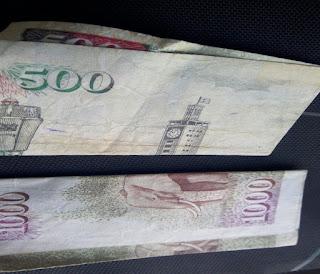 Corruption use money in any ways.[Photo : George]