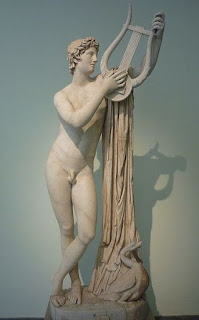 Greek God Apollo holding his Lyre.