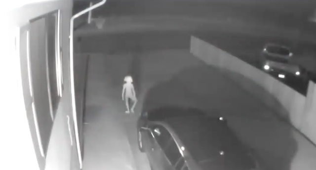 alien recorded on security cam walking away from house