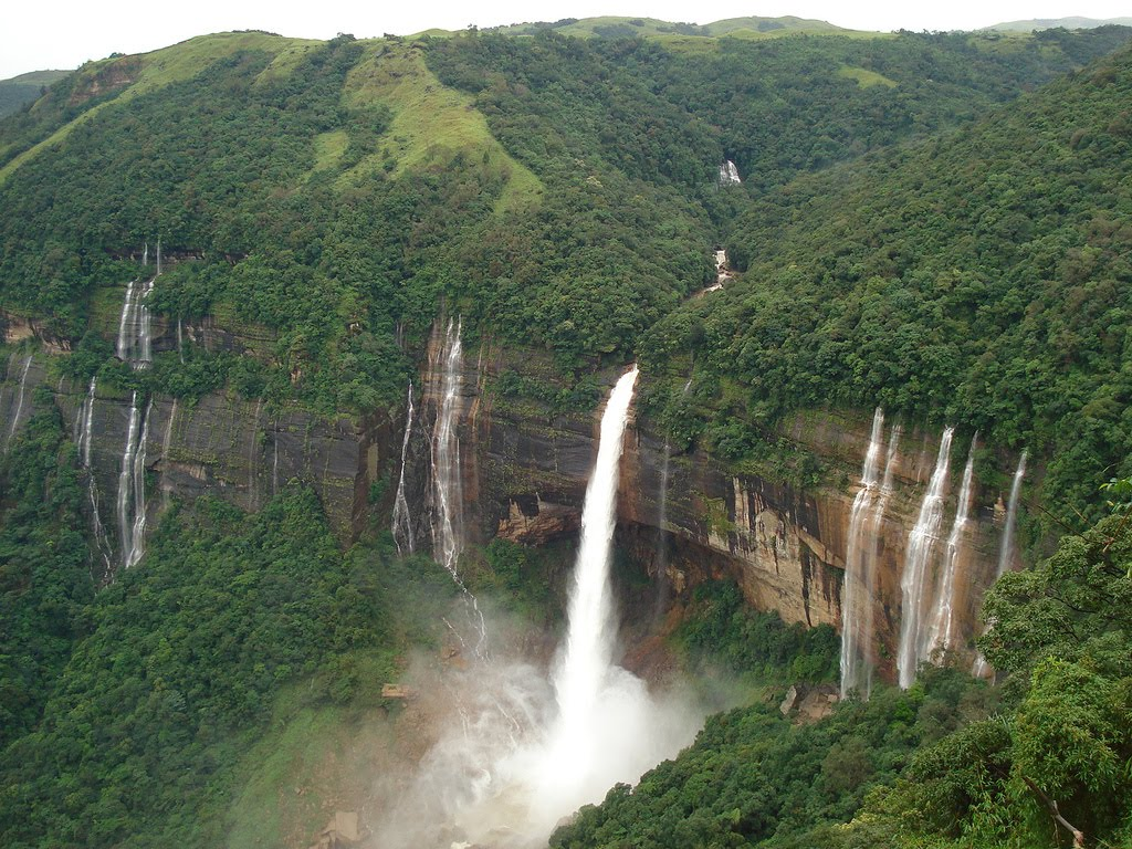 North east India - ridge, waterfall and dense green foliage