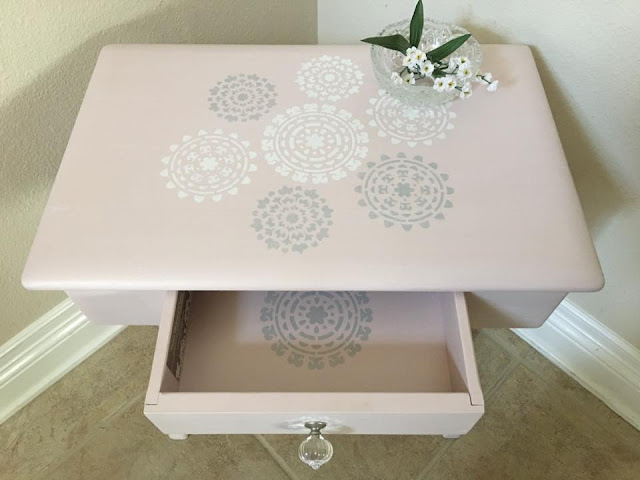 table with detailed paint job