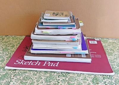 sketchbooks filled with drawings, journaling, lists, poetry