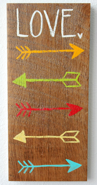 Love and Arrows sign hand painted on barn wood