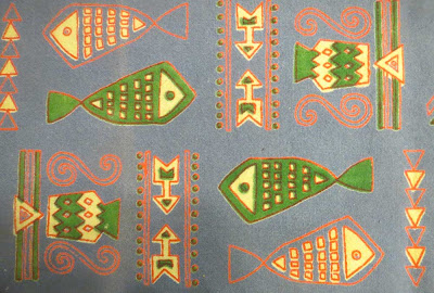 Tablecloth detail with green and bicolor fish
