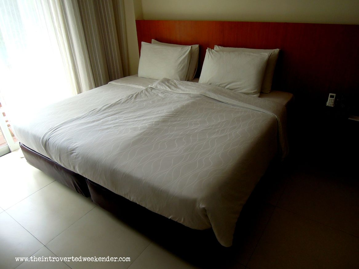 Our bed at Ocean Suites Boutique Hotel Bohol