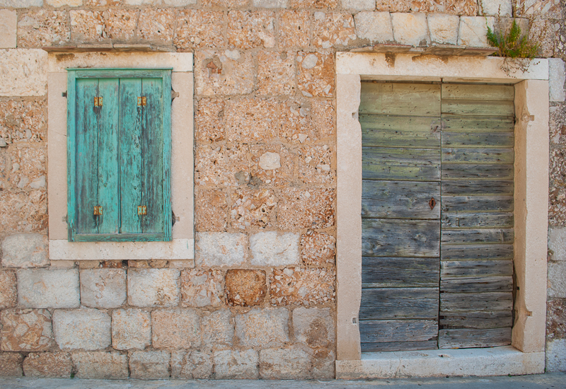 brick walls and wooden windows image of vis island in croatia