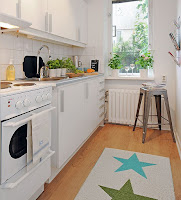 Nifty narrow kitchen design idea with white furniture and indoor plants decoration