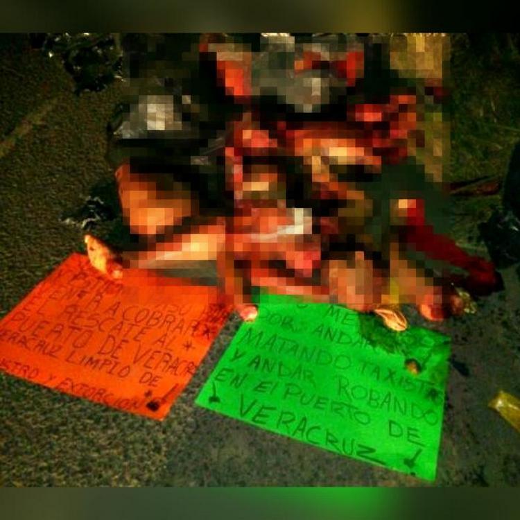 Fotos, Sicarios dejan cuerpos descuartizados de extorsionares en Veracruz