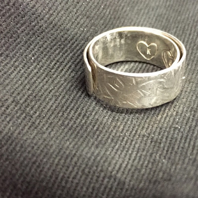 A silver wrap around ring