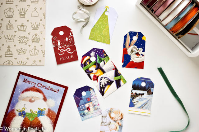 Materials for making diy gift tag ribbon garlands with old Christmas cards