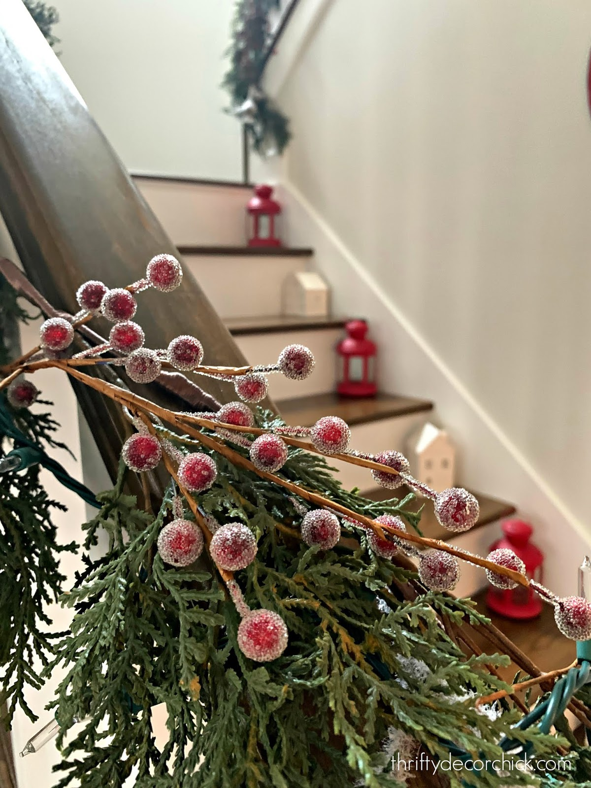 Filling stairway garland with berries and greenery