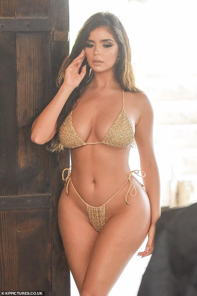 Demi Rose showcases her sensational curves in a skimpy gold bikini