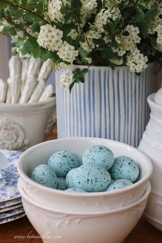 White bowls filled with faux blue speckled bird's eggs is the fastest, easiest way to decorate a table for Easter