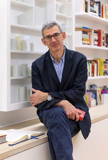 Edmund de Waal sitting in his library of exile exhibit